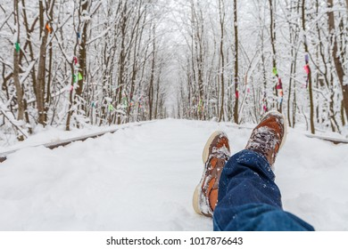 the man lies on snow against the background of the wood