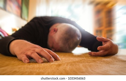 a man lies unconscious in his apartment