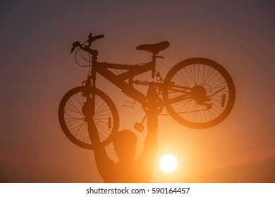 Man lifting a bicycle