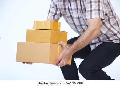 Man is lifting up three boxes on white background.