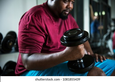 Man lifting weights at the gym