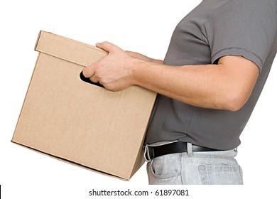 The man lifts a cardboard box