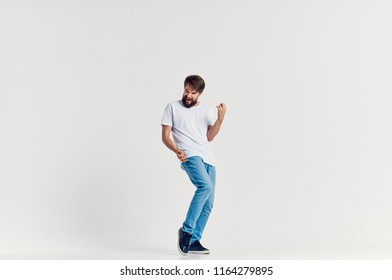 a man in light jeans imitates a guitar playing, a rich imagination