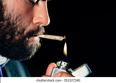 Man lighting and smoking a joint