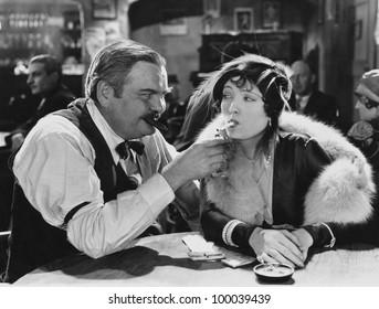 Man lighting womans cigarette