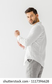 man in linen white shirt looking at camera isolated on grey background
