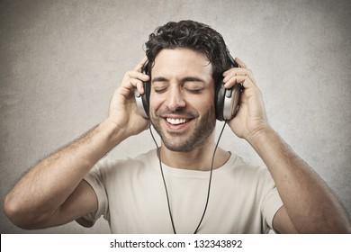 man listens music with headphones