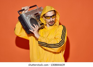 man listens to music in a tape recorder