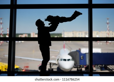 Man with little boy having fun at the international airport. Father with his cute little son waiting boarding. Family travel or immigration concept