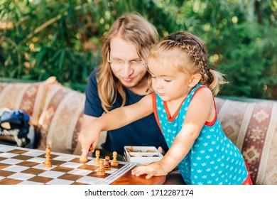 Man and little girl playing chess - Cirali, Antalya Province, Turkey