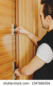 Man locking door of his home. Protection against burglary concept.