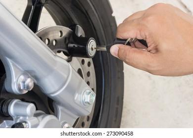 A man locking on motorcycle disc brake