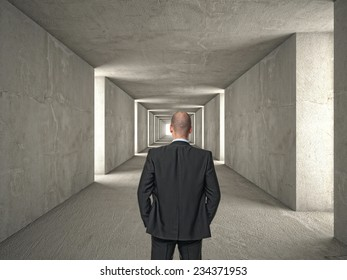 man and long concrete tunnel