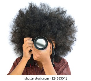 man with long hair and holding digital camera