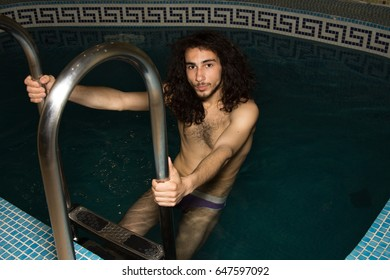 A man with long hair in the pool.