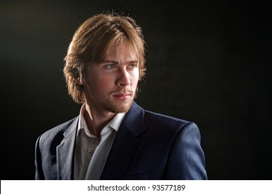 A man with long hair wearing a jacket