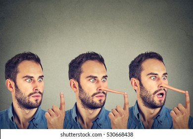Man with long nose isolated on grey wall background. Liar concept. Human face expressions, emotions, feelings.