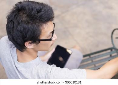 Man Look at Screen Tablet: Head and Shoulder Shot