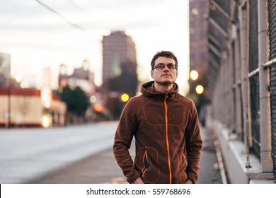 Man looking up against blurred bokeh city background