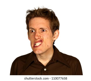 Man looking angry and making a strange sneering face, isolated on white background.