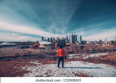 A man looking at Calgary city on a sunny day in winter at Alberta, Canada