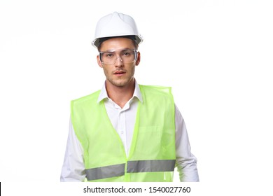 man looking at camera builder in helmet hard hat isolated background