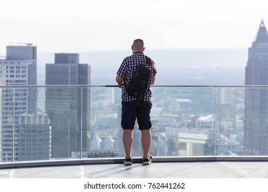 man looking at an cityscape
