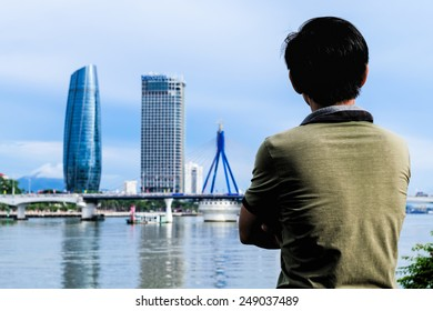 Man is looking to the cityscape in Danang