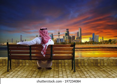 A man looking at the cityscape of kuwait