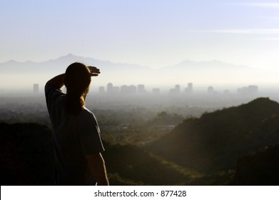 man looking at distant city