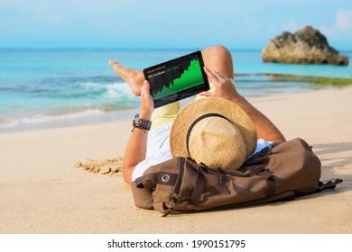 Man looking at his investment portfolio performance