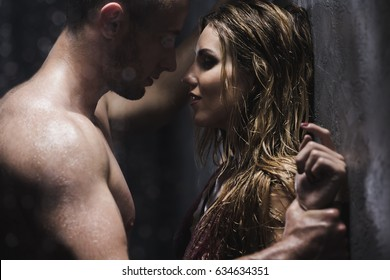 Man looking at his lover with desire during the intimate shower