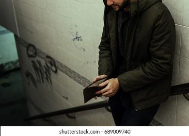 A man looking at his wallet
