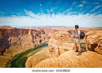 man looking to Horseshoe Bend at Utah, USA
