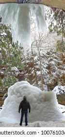 A man looking up at an ice formation in the Old Man's Cave area of Hocking Hills State Park, Ohio.