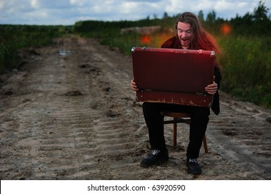 Man looking into the magic chest