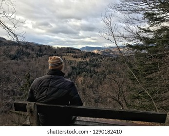 Man looking at Julian Alps Mountain. Julian Alps in the background. Slovenia, near to the Lake Bled. Winter. Top view.