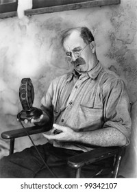 Man looking at a microphone
