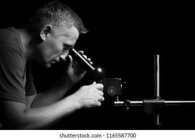 Man looking in microscope