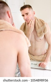 Man looking in the mirror after shower