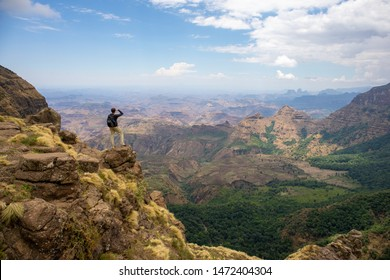 Man looking out at the beautiful landscape in Simien Mountains National Park, Ethiopia