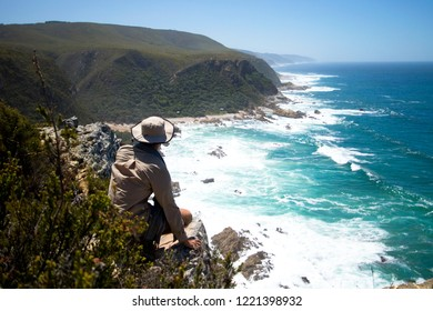 Man looking out over the Otter Trail