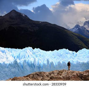 A man looking at Perito Moreno Glacier, Patagonia, Argentina