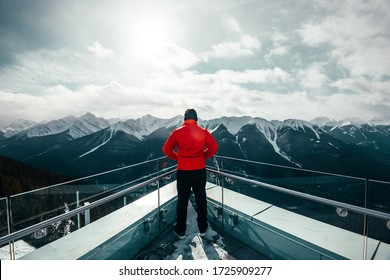 A man looking at Rockie Mountains from Sulphur mountains at Alberta, Canada