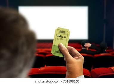 Man looking for seats in cinema