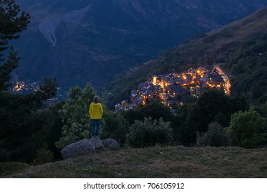 man looking at the small village of Taull, Vall de Boi, Lleida, Catalonia, Spain