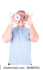 Man looking through the hole two donuts, one strawberry and one of chocolate on white background