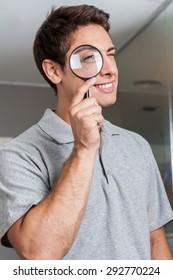 Man looking through loupe