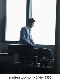 Man looking through window in office