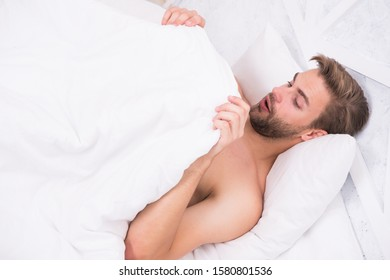 Man looking under blanket. Morning wood formally known nocturnal penile tumescence common occurrence. Male reproductive system. Why men get morning erections. Normal erections occur. Guy relax in bed. - Shutterstock ID 1580801536